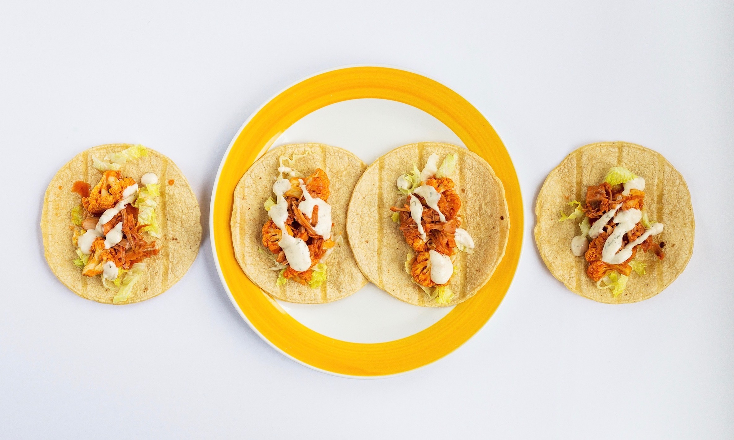 Sriracha Buffalo Cauliflower and Jackfruit Tacos